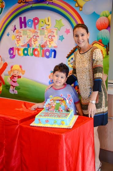 Christine Jacob-Sandejas and her son Jaime celebrate his moving up from preschool to grade school with a Jollibee Kids Party.